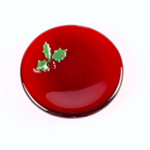 Small red glass dish decorated with holly leaves