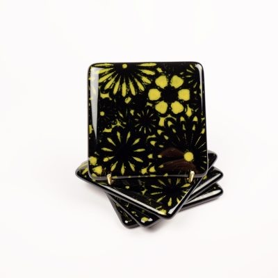 Black fused glass coasters with yellow flowers