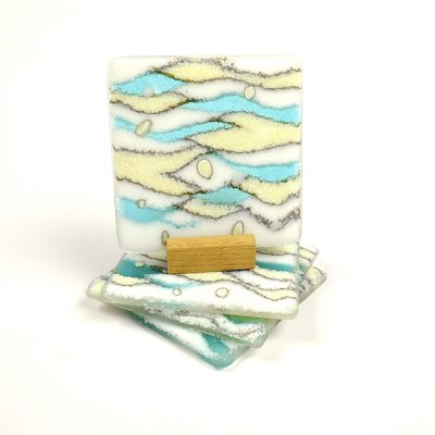 Fused glass coasters in turquoise and cream