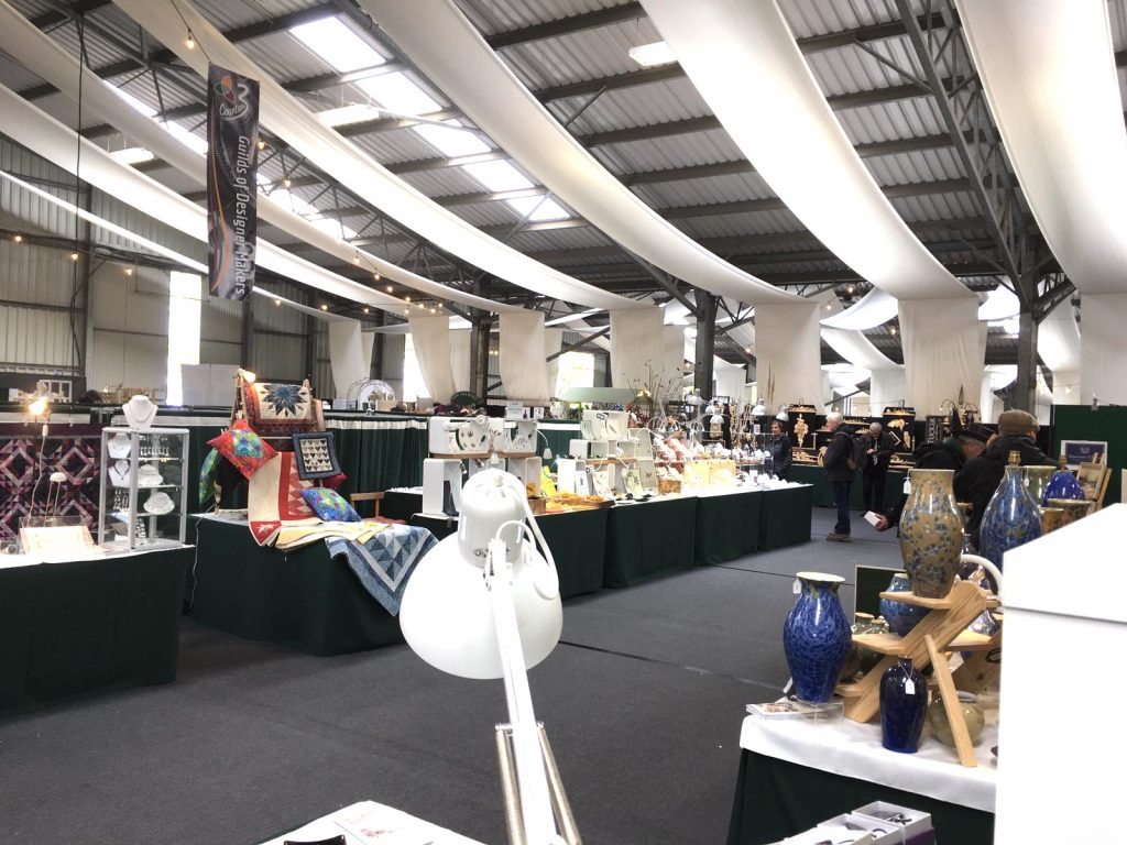 Image of craft fair showing stall holders
